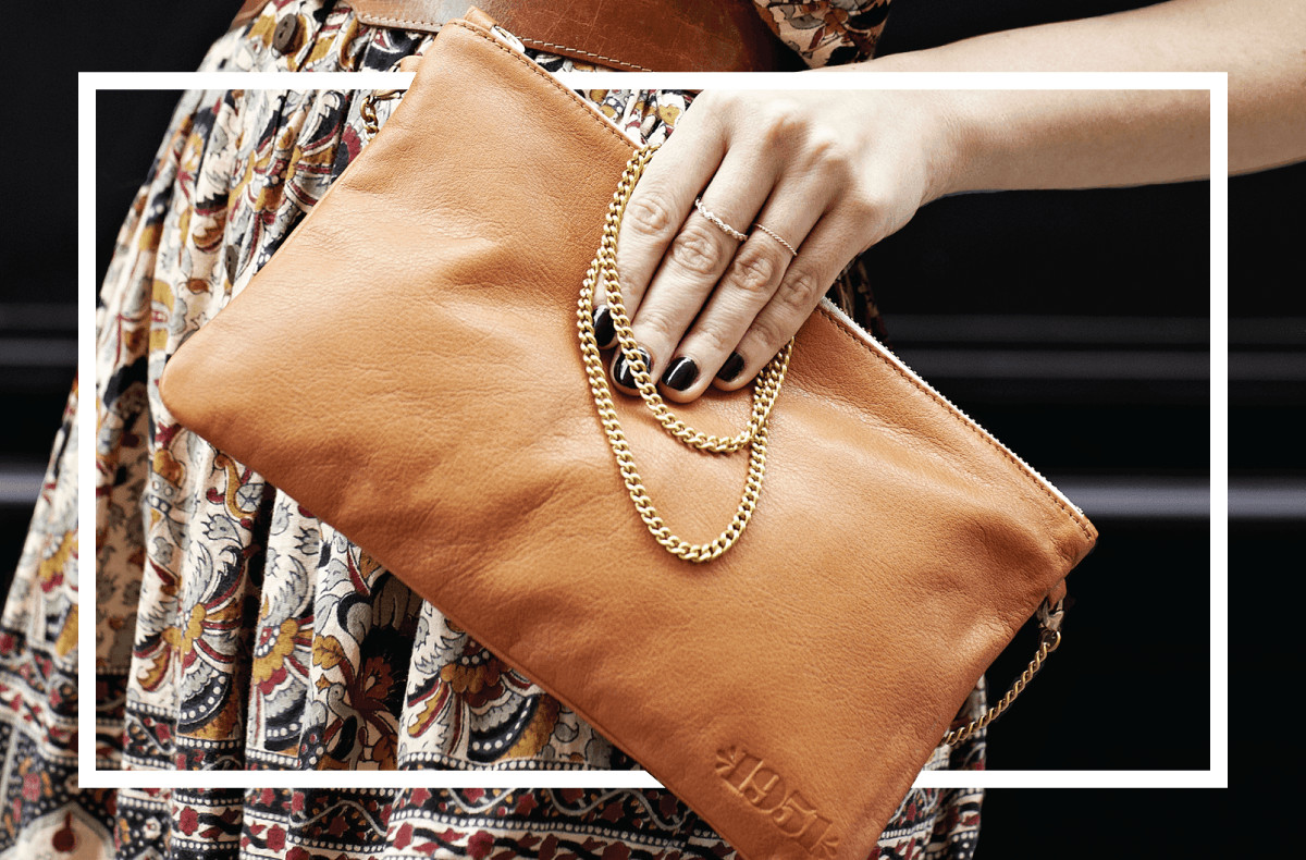 Woman Holding 1951 Maison Française Tan Leather Handbag