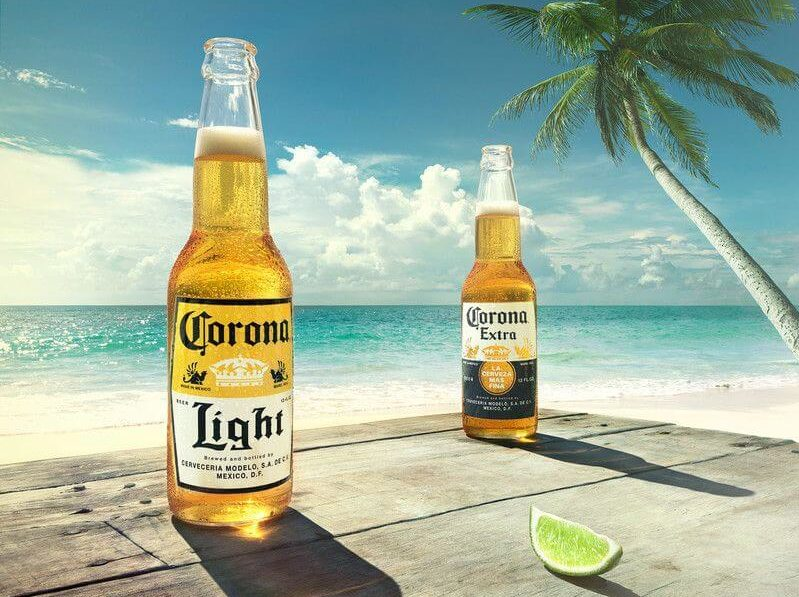 Two Coronas on Wood Table on Beach