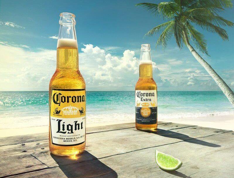 Two Coronas on Wood Table on Beach