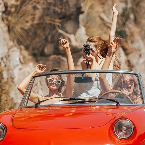 3 Women Ride in Red Convertible