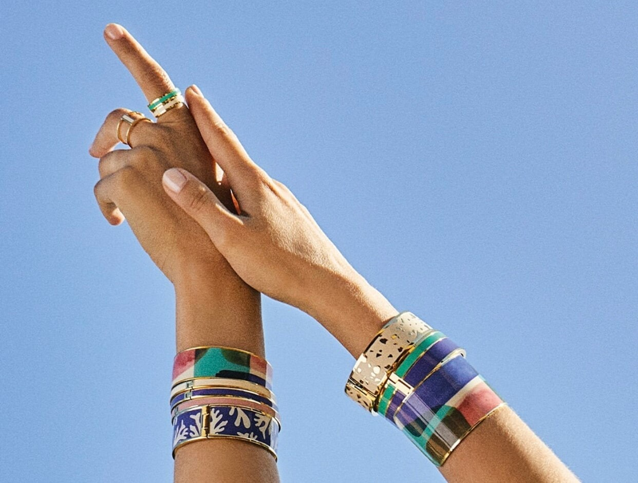 Hands in Air wearing Bangle Up Paris Bracelets and Rings in Blue, Pink, White, Gold & Green