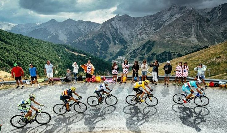Tour De France 2019 5 Bikers on Road through Mountains with Fans