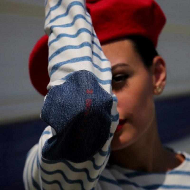 Woman wearing La Marinière Française Eloise Striped Denim Patch Tee elbow jean patch close up