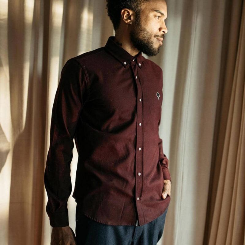 Man wearing Ivoy burgundy button up shirt