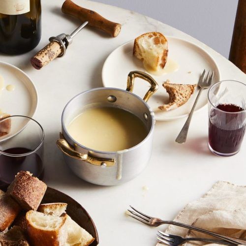 Fondue Fribourgeouis with Bread on a table