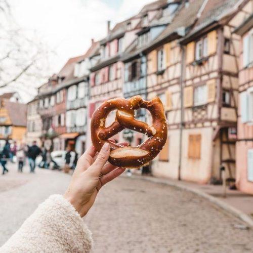 woman holding pretzel