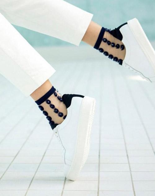 Black silk socks, white sneakers, white pants