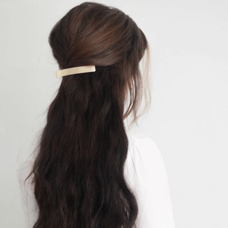 Brunette woman with Bachca Paris Round Metal Hair Barrette