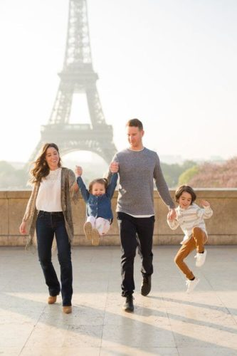 family of four in front of the eiffel tower