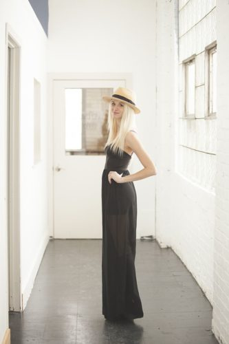 Woman in Black Dress with Fedora Hat