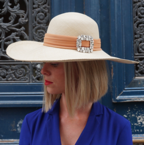 woman wearing wide brim hat and jewel clap