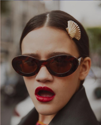 woman wearing glasses, gold clap