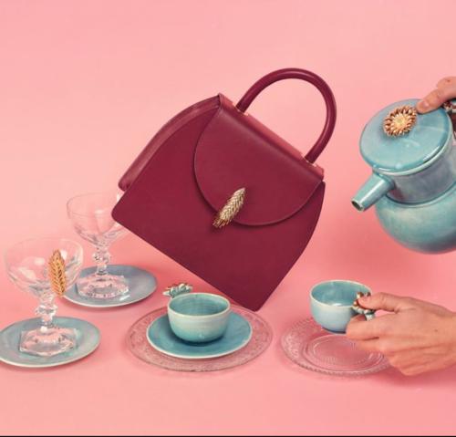 red handbag, teal blue tea cup set