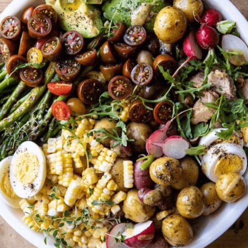 Nicoise Salad on wooden table